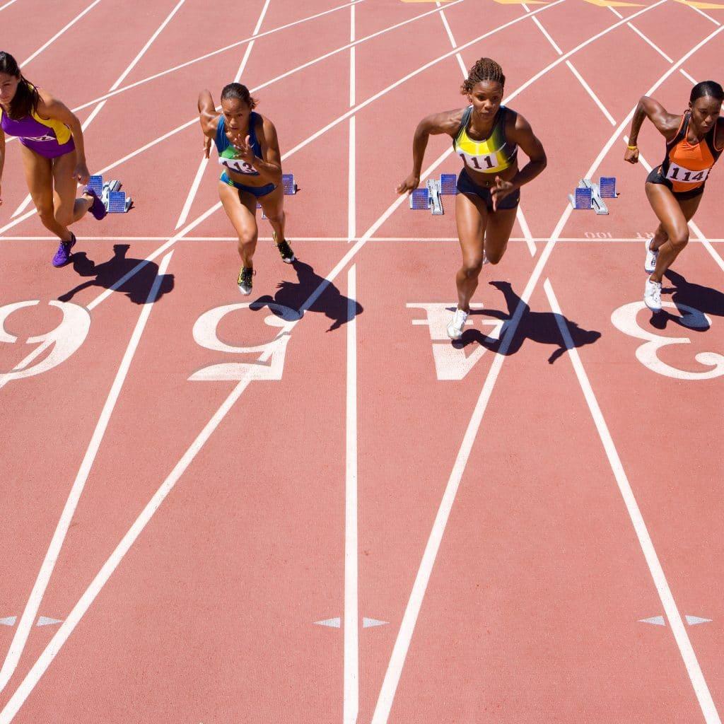 Four women running a race